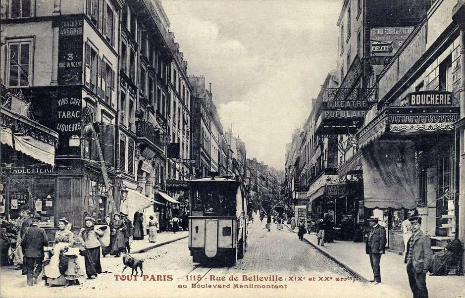 Belleville, Paris, early 20th century. This postcard image shows a tram (no longer there) running down Rue de Belleville at the corner of Boulevard Belleville. Wikimedia Commons