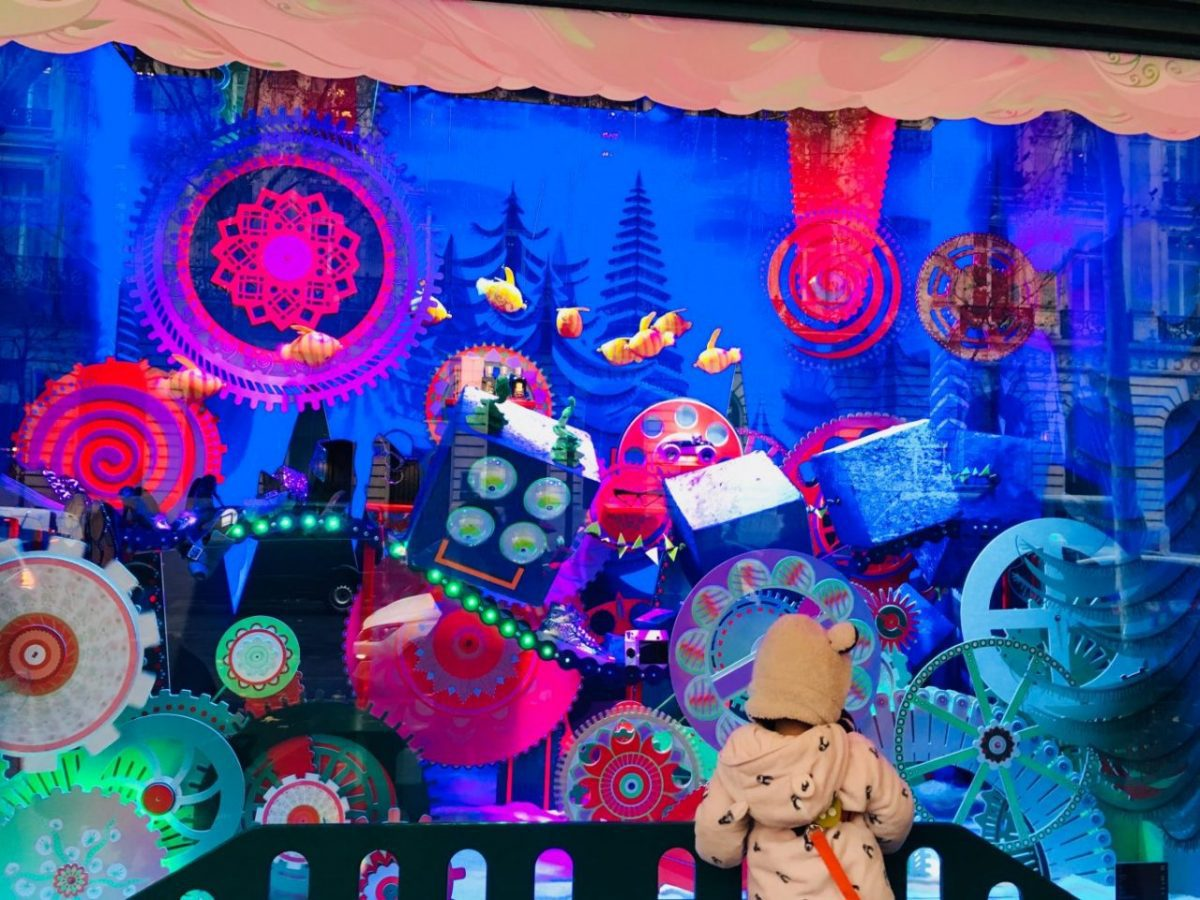 A young admirer checks out a Christmas window display at Galeries Lafayette in Paris, 2018.