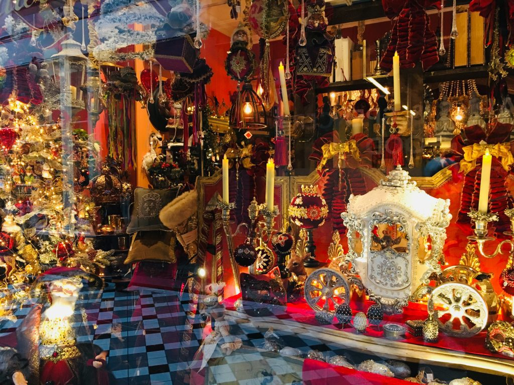 Paris Christmas decorations at a shop window in Paris, 2018. Image: Courtney Traub