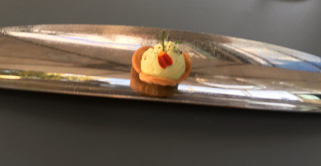 "The meal at Coretta in Paris began with a lovely ""amuse-bouche"": a tiny individual savory tart."