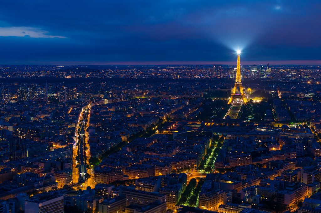 Paris at night, with the Eiffel Tower in the distance. Image credit: Shepard4711/ Some rights reserved under Creative Commons