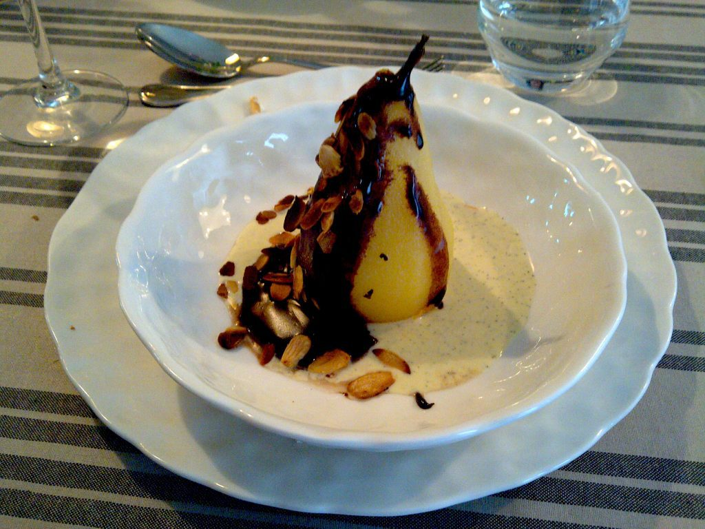 Poached pear with chocolate and vanilla sauces and almond shavings. Image: Colette Davidson/All rights reserved