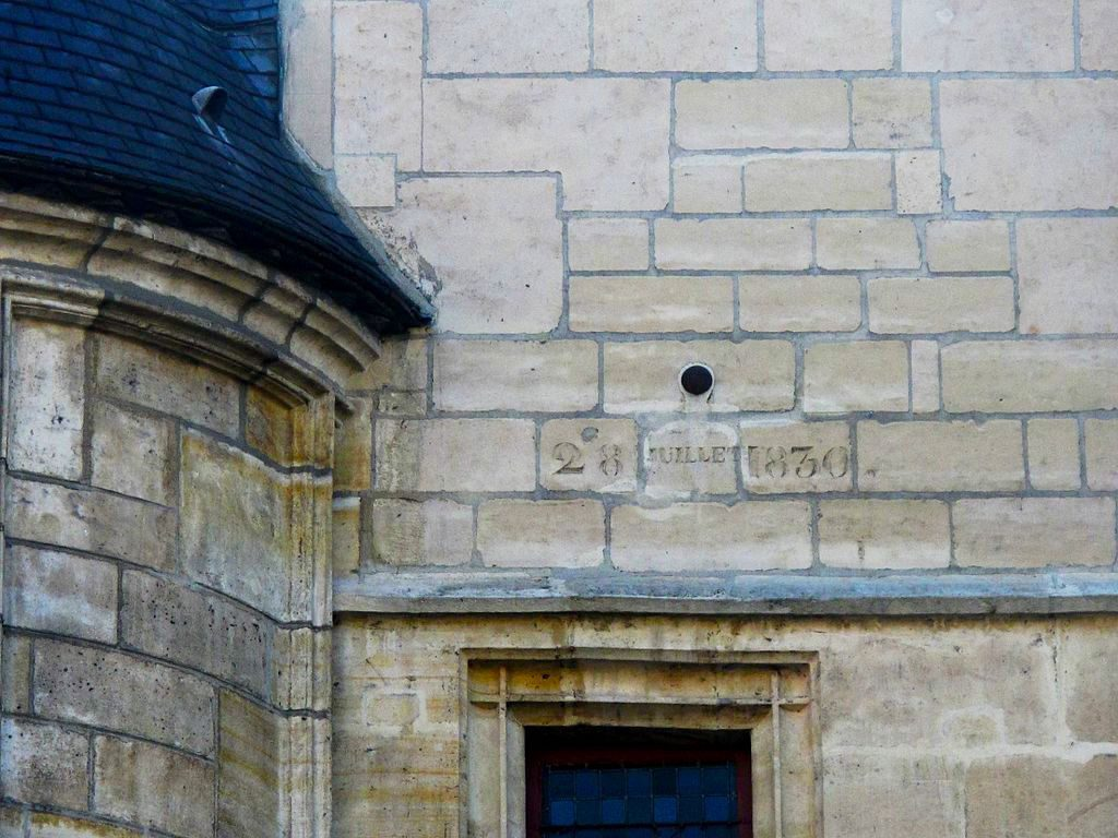 "A cannonball struck the Hotel de Sens during the ""Trente Glorieuses"" conflict in 1830. You can see the inscription below. Image: Tangopaso/Public Domain"