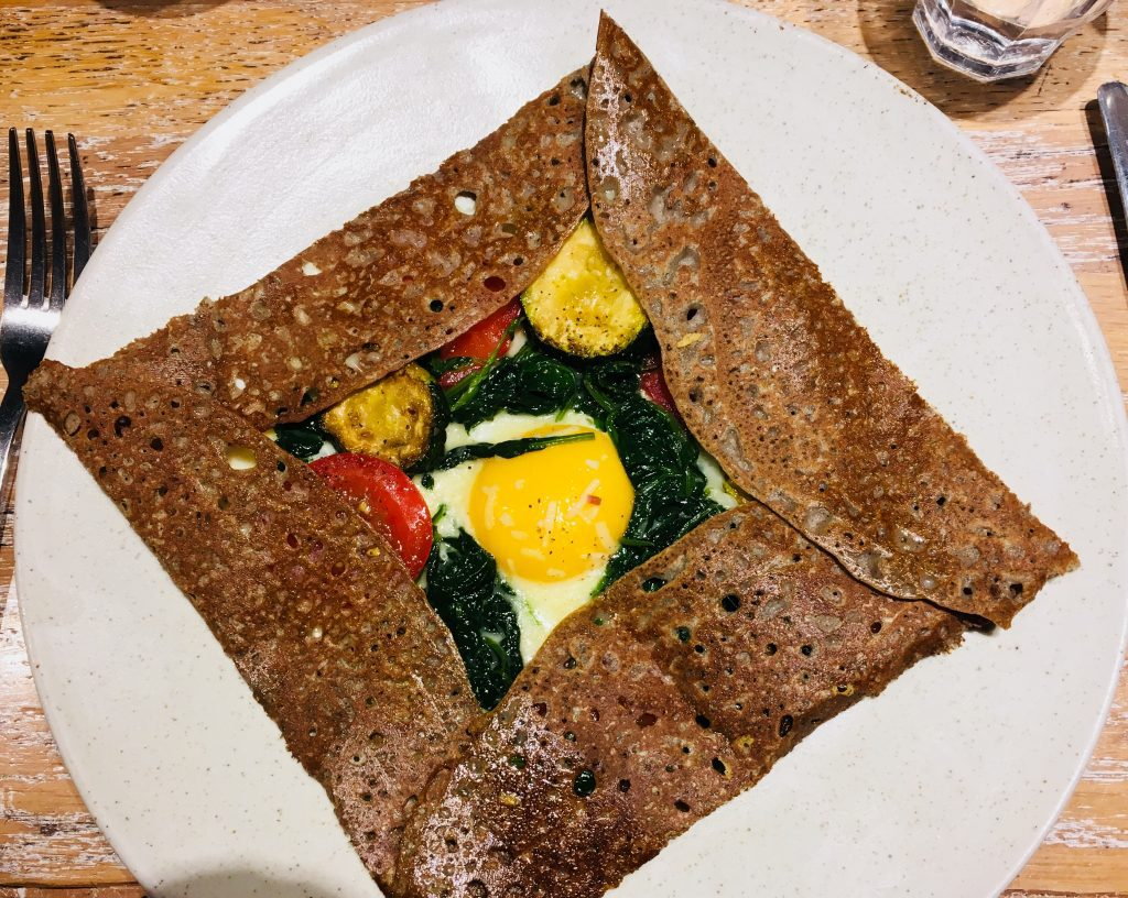 "Egg, zucchini, fresh spinach and tomato savory crepe (or ""galette"" at Breizh Cafe in Paris. Image credit: Courtney Traub/All rights reserved."