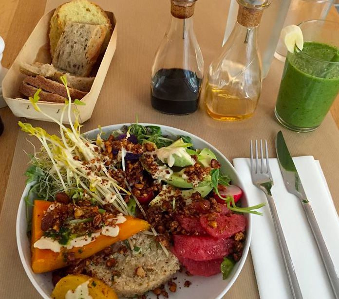 "A raw ""supersalad"" at Le Potager de Charlotte, accompanied by a fresh-pressed juice. Image: Official FB page"