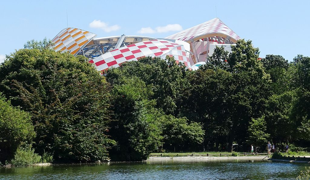 The rooftop of the Fondation Louis Vuitton, designed by Frank Gehry, as seen from the Bois de Boulogne. Wikimedia Commons