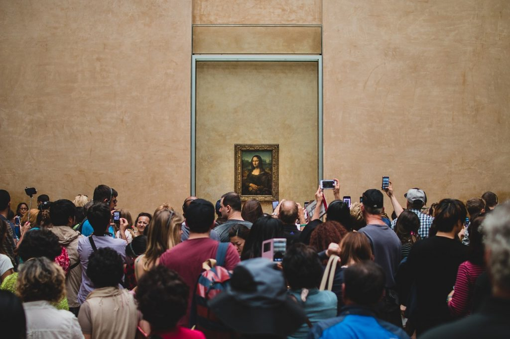 The Mona Lisa at the Louvre: Thick crowds and heavy glass can make your experience of it a bit underwhelming