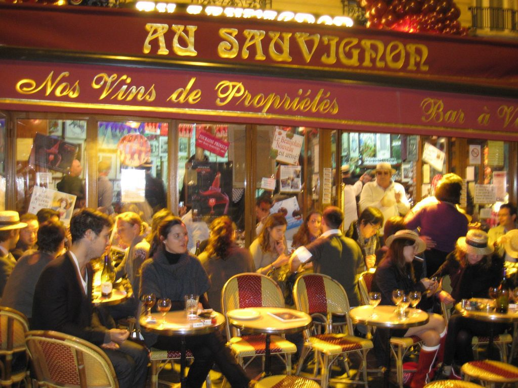 "The busy terrace at Au Sauvignon, a popular traditional ""bar à vin"" in Paris."