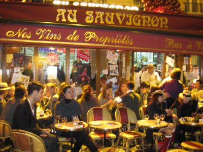 Busy terrace at Au Sauvignon, a popular bar a vin in Paris, France.