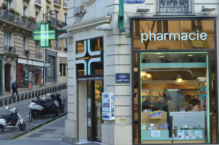 pharmacy and green sign in paris france