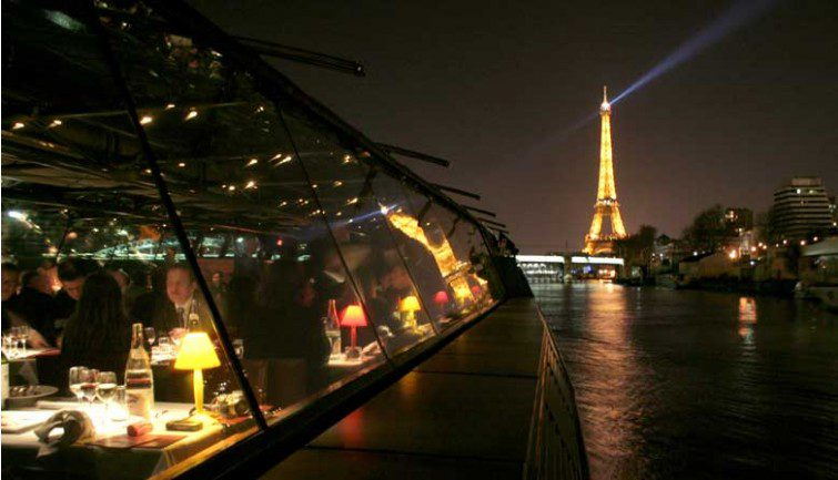 Dinner cruise in Paris with the Eiffel Tower in the distance.