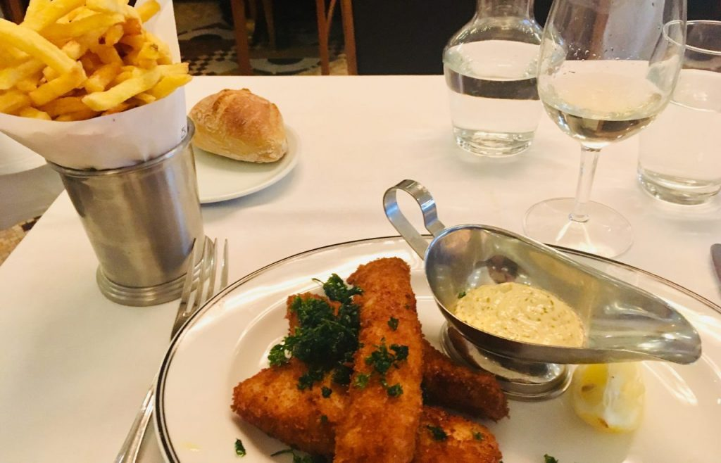 Fish and chips with tartare sauce and fresh parsley at La Coupole, Montparnasse. Image: Courtney Traub/All rights reserved