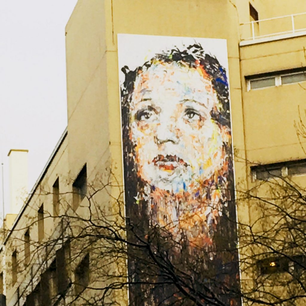 A mural commemorating Edith Piaf graces a wall of the Tenon Hospital, near Gambetta in Paris. Courtney Traub/All rights reserved