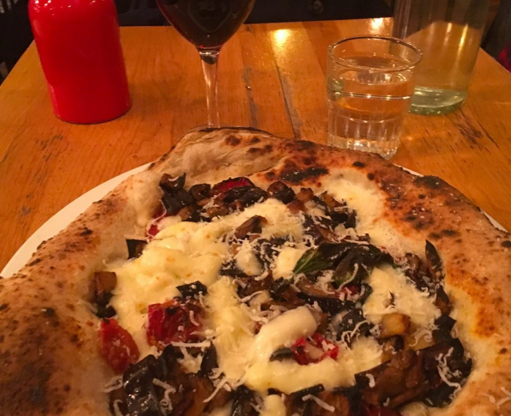 Superb wood-fired pizza and a glass of Italian red at Popine, Paris. Image: Courtney Traub/All rights reserved